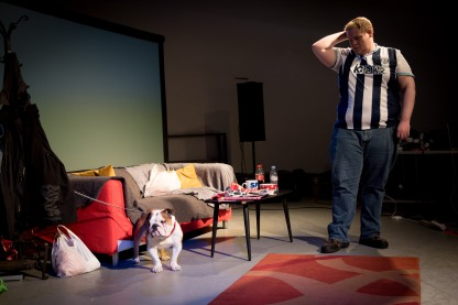 In the photo, the man in the West Bromwich Albion shirt known as Bubble is alone with the dog, scratching his head.