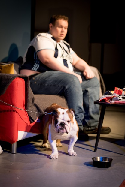 he man in the West Bromwich Albion shirt known as Bubble is sitting with dog