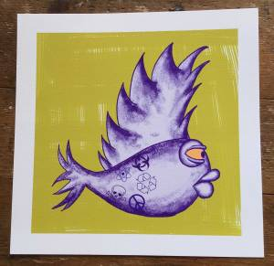A purple fish with large pouting lips and protruding organge eye and a large vertical dorsal fin that resembles a Mohican hair cut. The tail fin is also spikey. Towards the tail of the fish there are symbols in darker purple, peace, recycling, skull & crossbones, atom and biohazard. The purple fish is on a yellow background with obvious brushstrokes. The yellow background is painted on a white background. The picture is photographed against wooden boards.