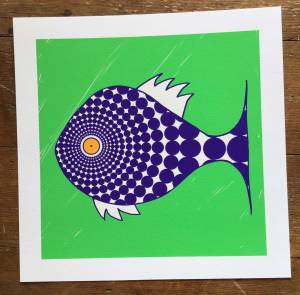 drawing of blue fish with pattern and yellow eye